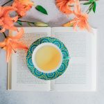 Tea cup on top of a tea book